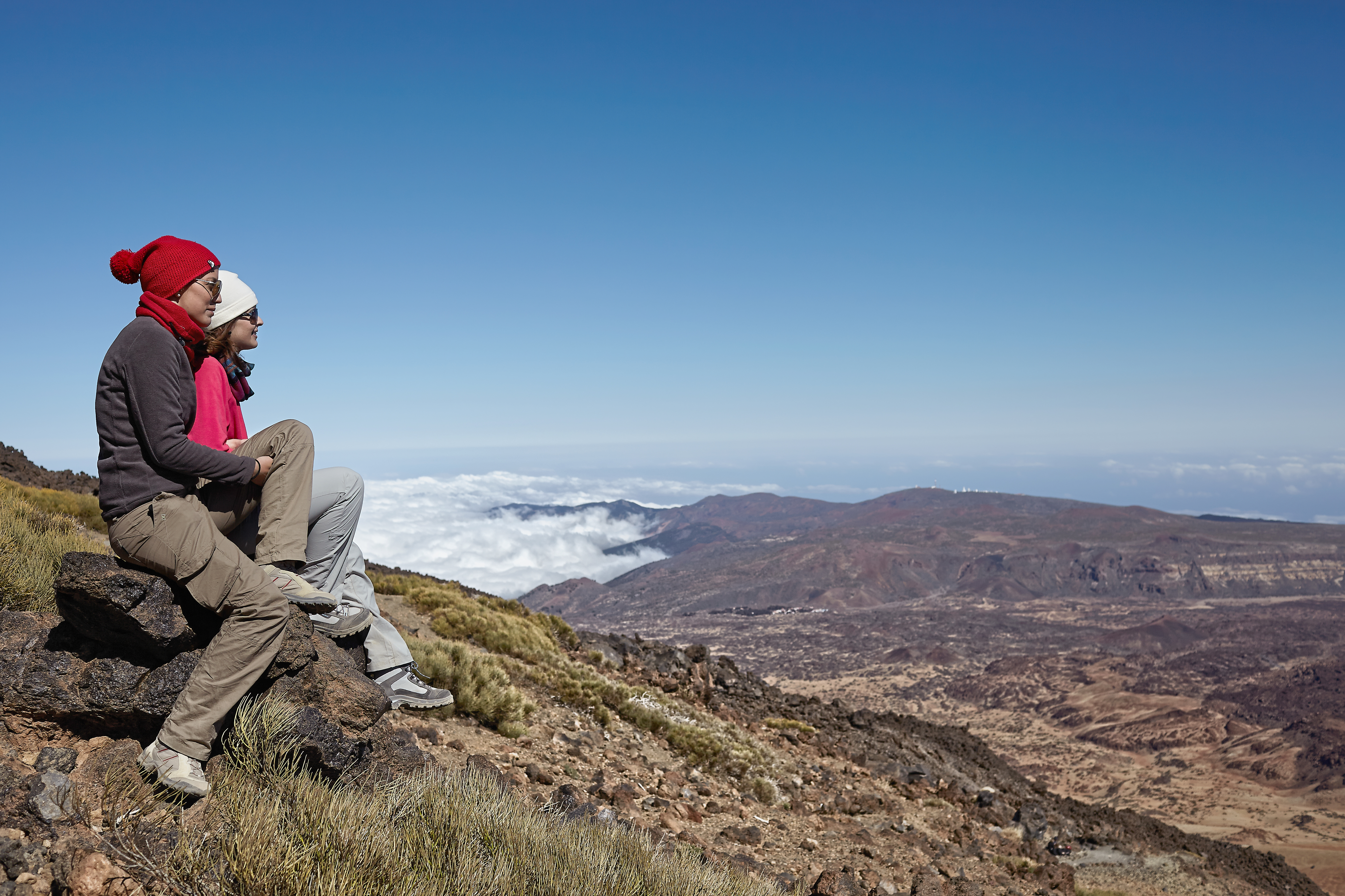 Hikers admiring the landscape from the top of Mount Teide